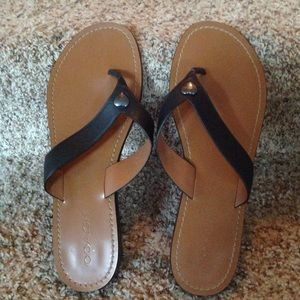 Black Coach Leather Flip Flops With Silver Heart